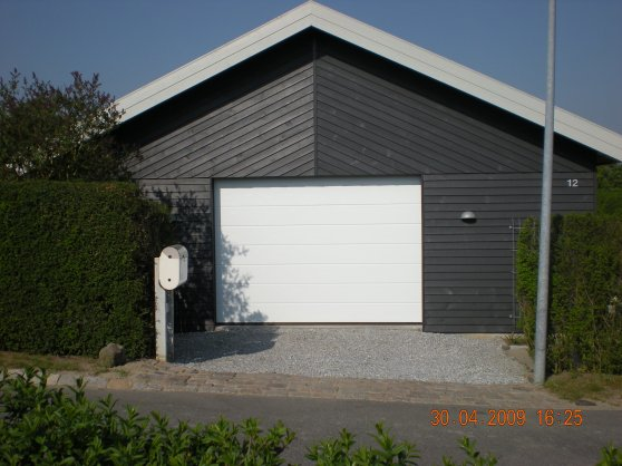 Vis dit v rksted vwnettet for Tre bay garage